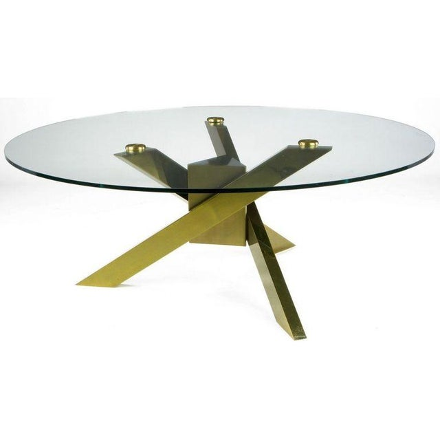 Wonderfully designed patinated brass post modern coffee table with mitered legs and elongated triangular center. Solid...