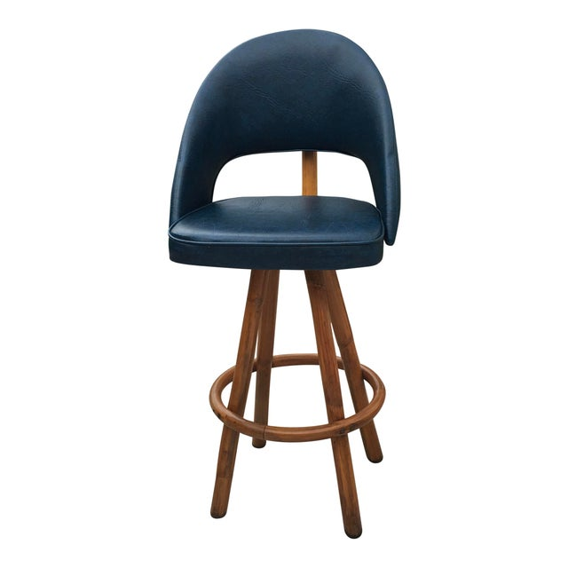 Vintage swivel barstools. With a durable fake leather blue fabric and bamboo. Solid wood bottom thick foam cushions make...