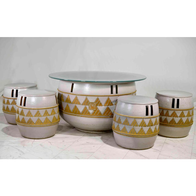 Fabulous and interesting dining set for indoor or outdoor use. Made in Korea by the Woon Bo Ceramic Lab, perhaps in the...