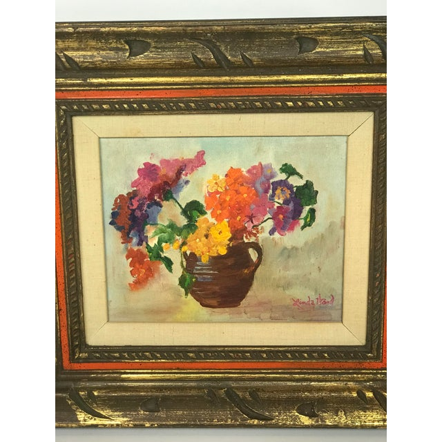 Beautiful floral still life. A vase filled with multi colored flowers. Colors are yellow, orange, pink, purple, red,...