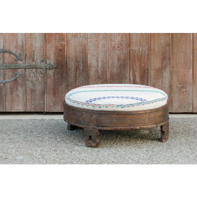 Adorable antique ottoman with a cotton seat, upholstered in a gorgeous vintage Kantha fabric, sits on a sturdy wood round...