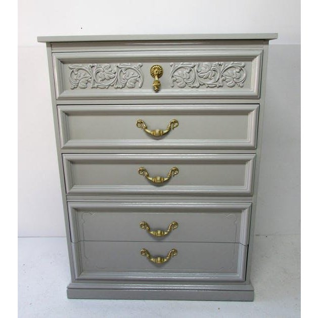 Midcentury Dixie chest of drawers newly lacquered in a high-gloss gray finish. Features intricate carving on top...