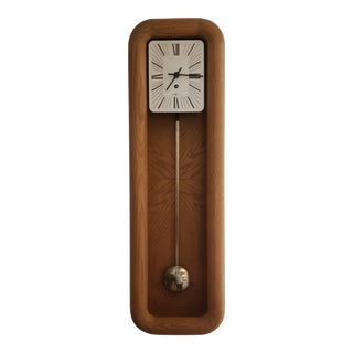 1970s Arthur Umanoff for Howard Miller Solid Wood Pendulum Wall Clock For Sale