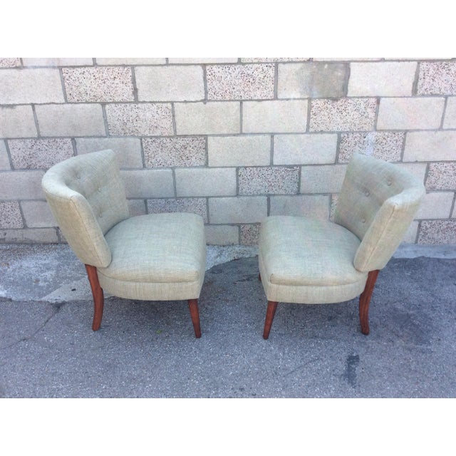 Pair of beautiful mid-century slipper chairs with pale green linen that has a slight blue stripe running through it. Very...