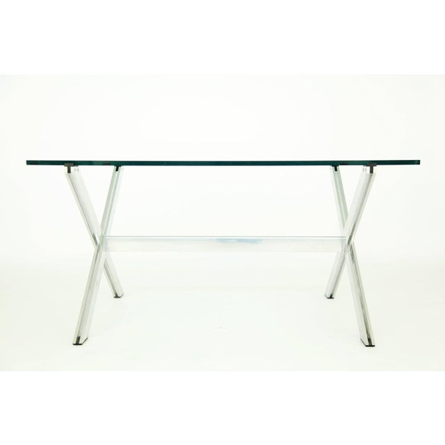 John Vesey for a commissioned interiors, parallel bar table Stainless steel with plastic feet and claws for surface. We...
