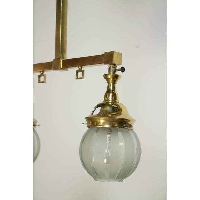 Small two light gas fixture. Brass with original Welsbach Mantle burners, that have been electrified and glass shades. C....