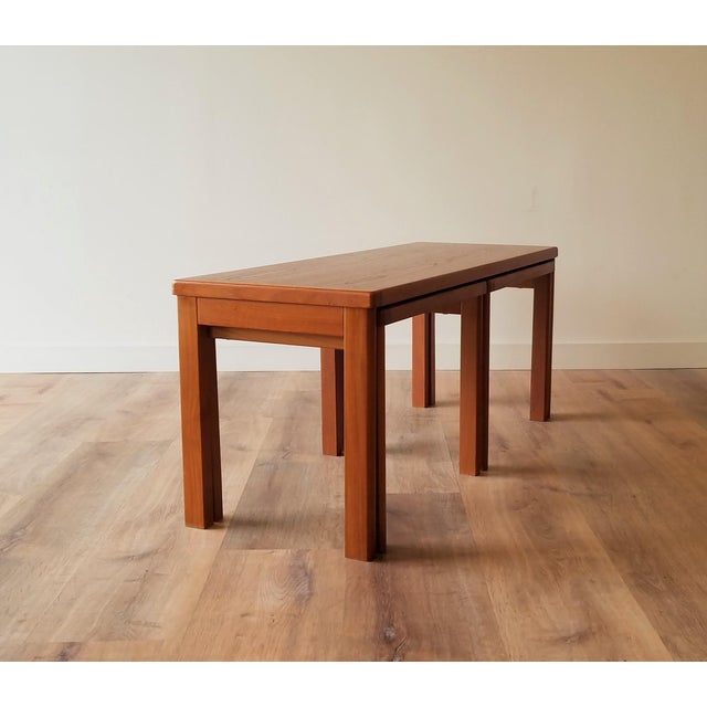 A very unique Danish teak coffee table with nesting side tables made by Vejle Stole & Møbelfabrik. A very compact design...