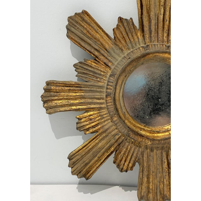 Lovely small sunburst mirror, prefect as an accent piece. The mirror has been antiqued so it is not usable as a vanity...