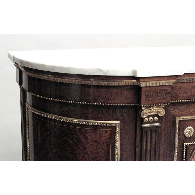 French Louis XVI style (19th century) inlaid two-door sideboard cabinet with bronze trim and white marble top.