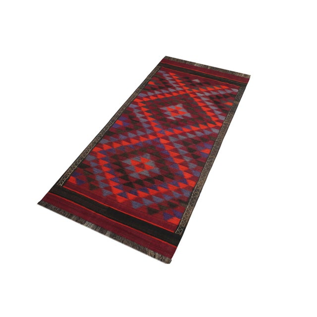 """Add a touch of elegance to your home with this vintage antique tribal Kilim rug. Constructed on a loom by Nomad Turkman..."