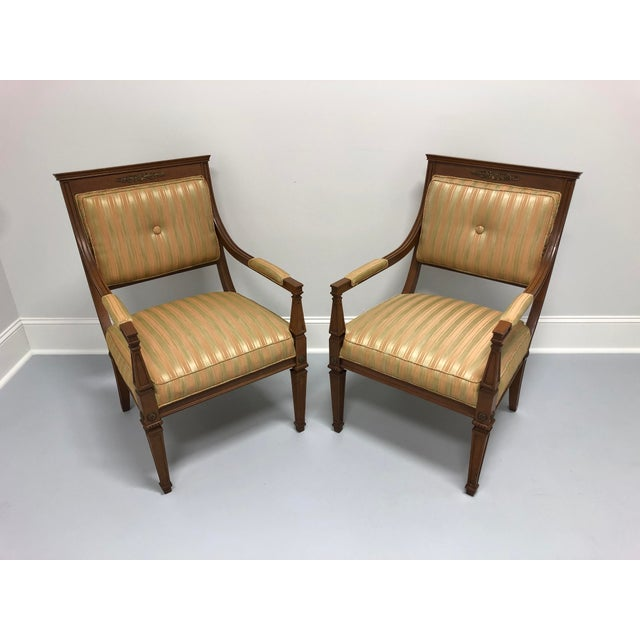 A pair of French Provincial Louis XVI Style lounge chairs. Made in the USA in the mid 20th Century. Overall: 23.5w 26.5d...
