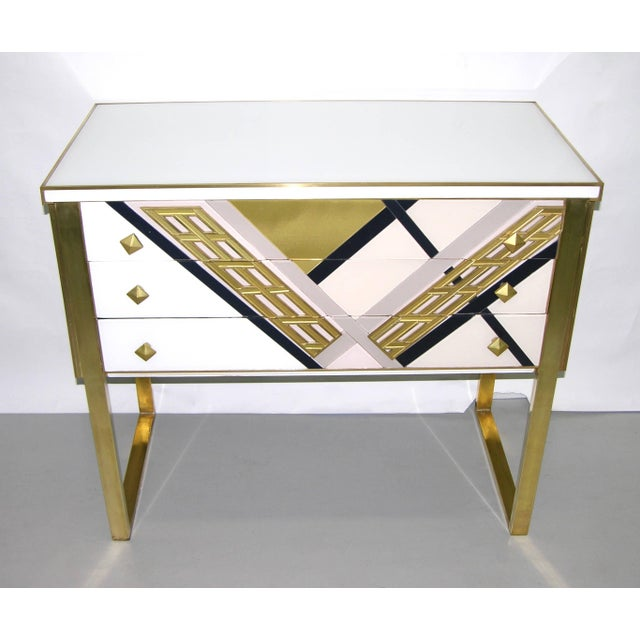 One of a kind modern three-drawer sideboard or console, entirely handmade in Italy, very attractive design, the surround...