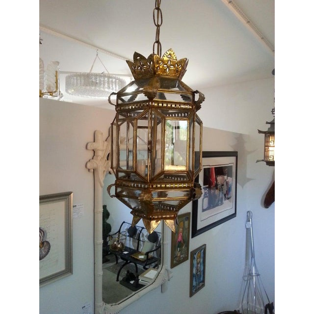 Vintage Spanish Colonial Style Chandelier from a Palm Beach estate. Gilded tin from Mexico. Note: Dimensions not including...