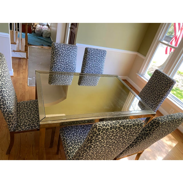 This dining table set features an expandable table by Mastercraft. It is similar to the ones by DIA as well. It has no...