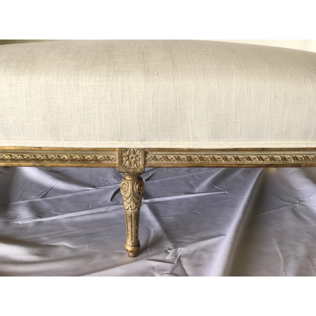 Vintage Gilt French settee newly reupholstered in an Ivory linen.