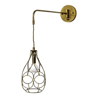 Contemporary Long Arm Hanging Brass Cage Sconce With Circle Motif For Sale