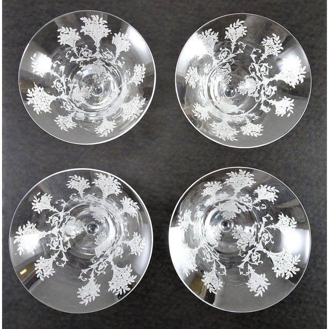 """Beautiful champagne/cocktail glasses. Etched with elegant floral design. No markings on bottom. Glass is 4"""" wide on the..."""