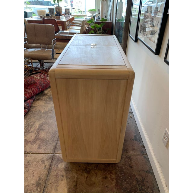 Retro and stylish, this gorgeous vintage hideaway bar cabinet by Thomasville furniture is sure to make a talking piece in...