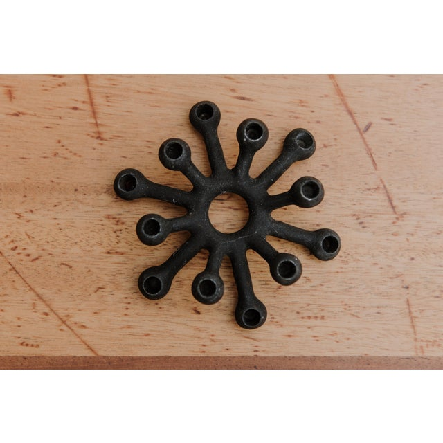 Jens Quistgaard's cast iron candle holders were much like his now famous pepper grinders; sculptural, organic and very...
