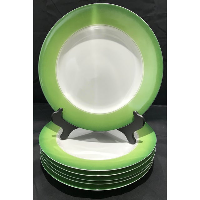 Set of 6 Lynn Chase chargers. These very collectible accent plates feature a bright white center with a green gradient...
