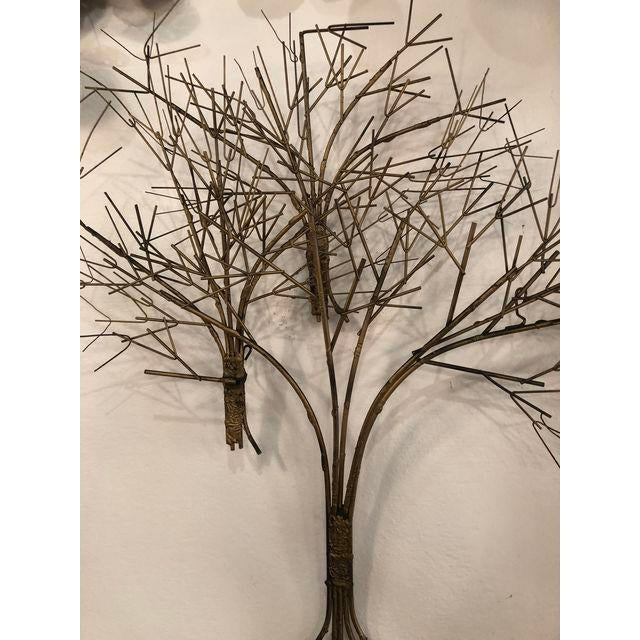 Lovely vintage metal wall tree sculpture. Comes ready to hang.