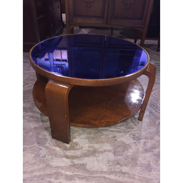 """Captivating, round, Mid-century Modern table featuring a vivid, cobalt blue glass top. 15 1/4""""h x 26 1/2""""to top x 30 1/2""""w..."""