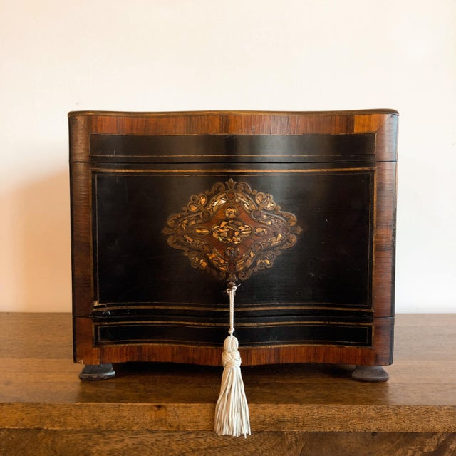 Antique 19th Century French tantalus liquor cabinet with brass and mother of pearl inlay, ebony wood, and rosewood...