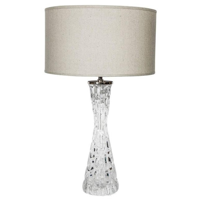 Pair of stunning Mid-Century Modern Swedish crystal lamps. The lamps have hourglass forms with textured ice glass design....