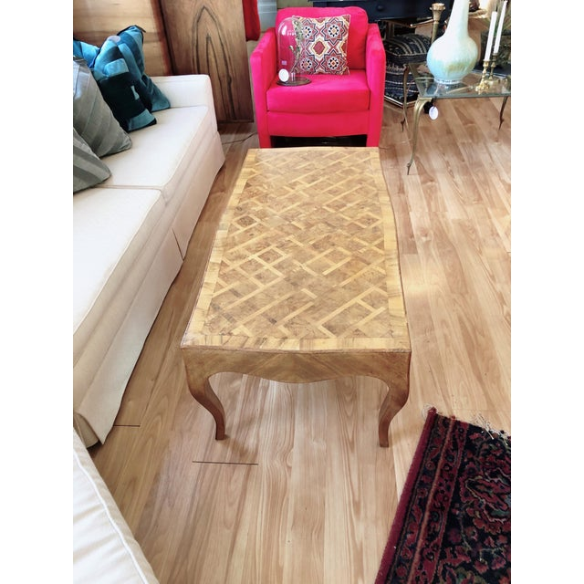 The height of sophistication, elegance and simplicity. This table has a gorgeously intricate marquetry design with book-...