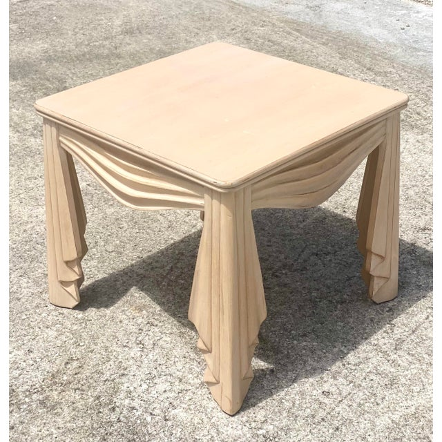 A fantastic vintage Regency side table. Carved swag with draped detail in a pale ash wood. A special addition to any...