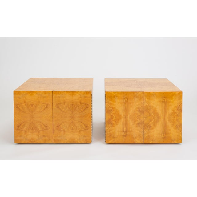 A versatile pair of storage pieces or side tables have a simple design, distinguished by the highly figured, bookmatched...