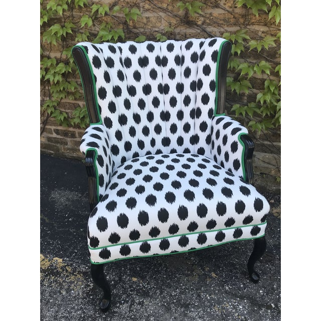 brand new upholstery job, legs refinished in semi gloss black... impeccable chair with show stopping fabric...