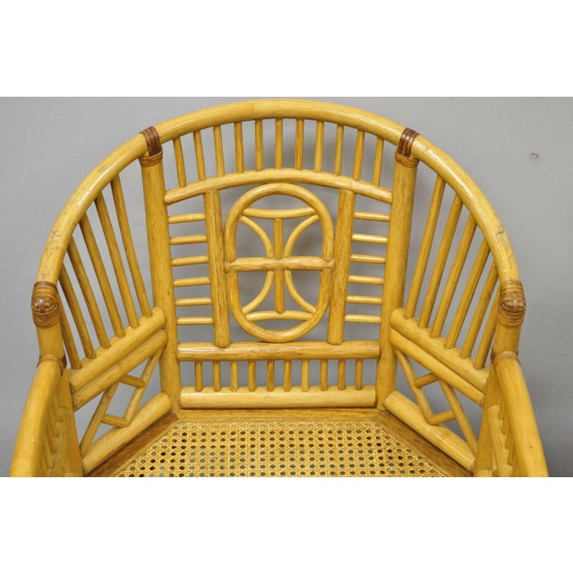 Pair of Vintage Brighton Pavilion Style Bamboo & Cane Rattan Arm Chairs (A). Item features cane seat, fretwork design,...