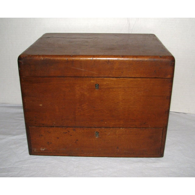 A 19th century antique doctors traveling apothecary cabinet. This cabinet is from the late 1800s and was typically used by...