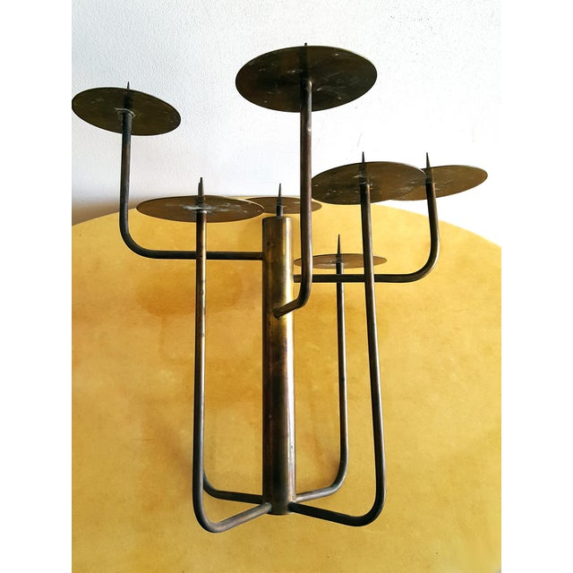 1950s brass studio candelabra comprised of eight brass arms emanating from the circumference of a larger central column....