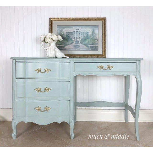 Vintage Dixie French Provincial desk in fabulous condition. It has the original hardware and has been painted in shades of...