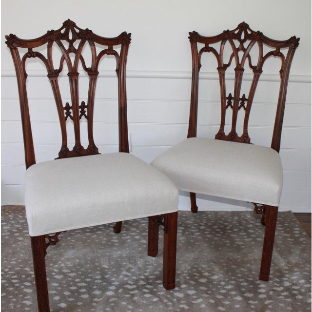 Elegant pair of carved mahogany Chinese Chippendale hall/side chairs. Finely constructed with detailed Chinoiserie...