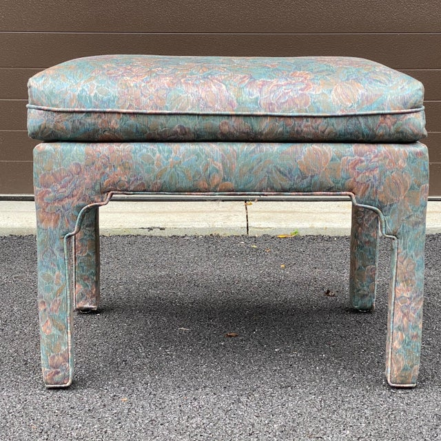 A quality fully upholstered bench with a fixed seat cushion & welting detail.