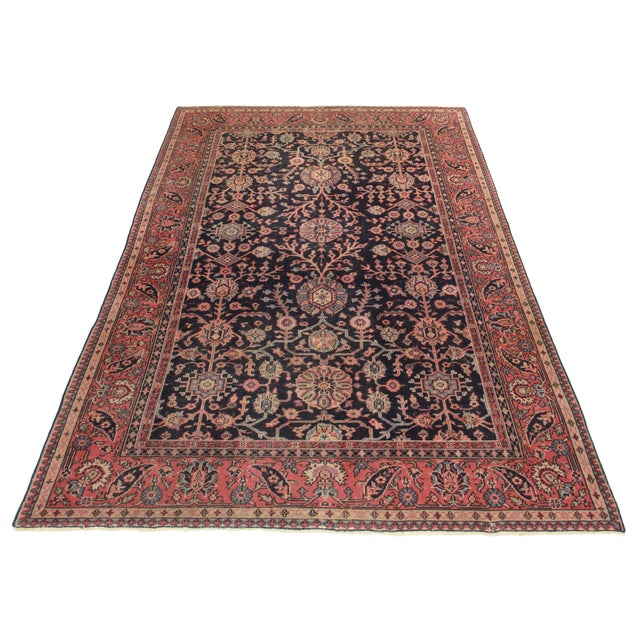 This is an antique hand knotted wool Turkish Sparta rug with all over design.