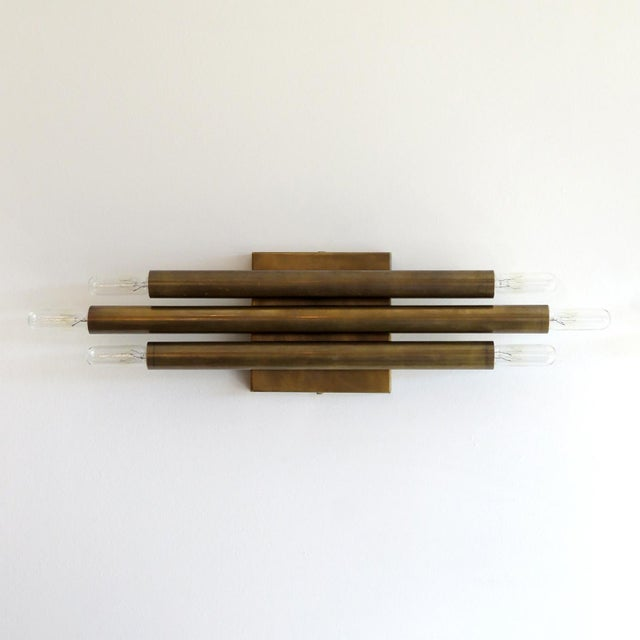 Great pair of geometric wall lights by Gallery L7 with three brass double candles.