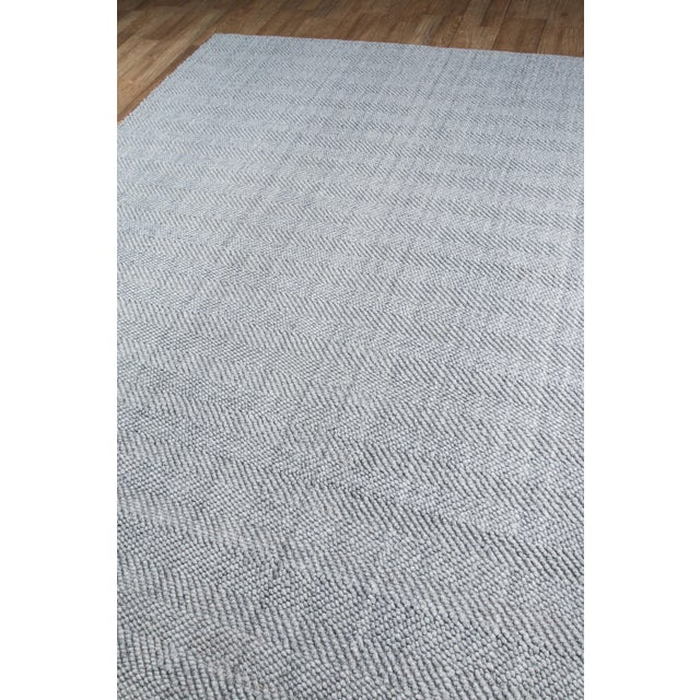 Simple and chic, this decorative area rug collection offers a fashionable foundation for modern floors. Available in gray,...