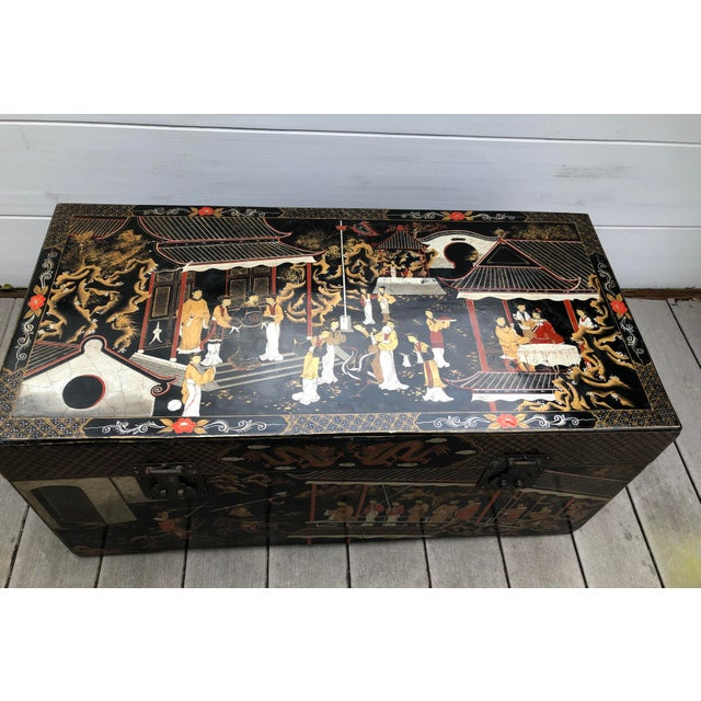 Large vintage Asian wood storage chest. An abundant of lovely, hand-painted picturesque outdoor garden scenes decorate the...