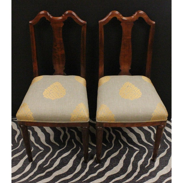A pair of mahogany side chairs with pineapple upholstered seat