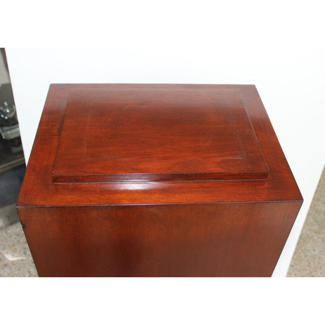 This stylish, clean-lined and large scale mahogany wood pedestal is the perfect piece to display a sculpture on. Note: Top...
