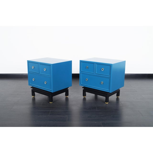 Pair of fabulous vintage lacquered nightstands by American of Martinsville. Newly refinished in a laguna blue finish with...
