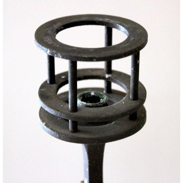 Offering a pair of 1960s iron candlesticks designed by Jens Quistgaard for Dansk.