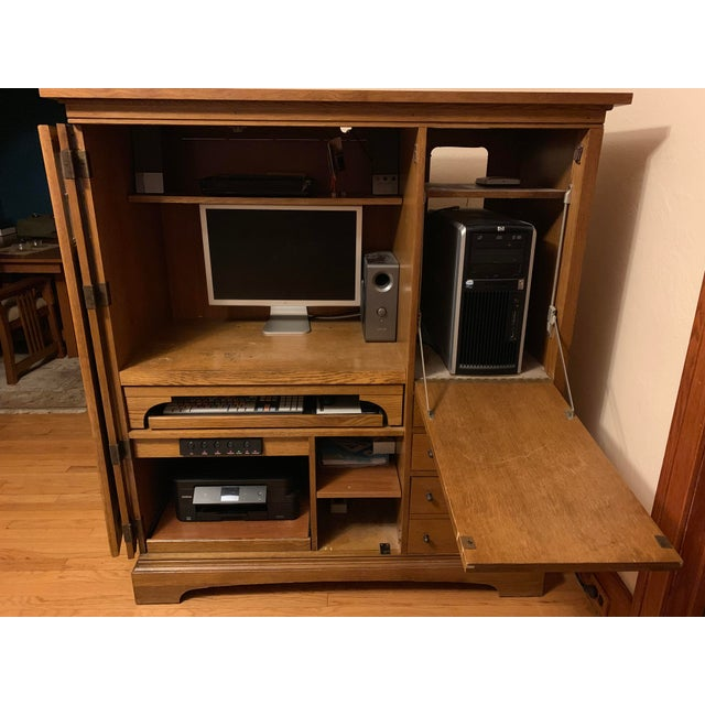 Hooker Brookhaven computer cabinet. Mission oak finish w/ glass inlaid panel door. Surge protected 4 outlet power switch...