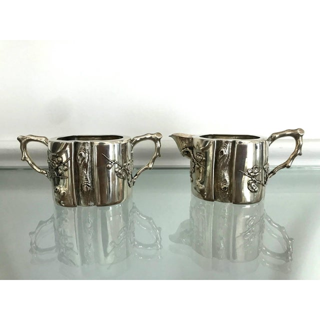 """A two-piece set sterling silver creamer and sugar made signed """"An Chang"""" in Chinese and """"Luen Wo"""" in English, circa early..."""