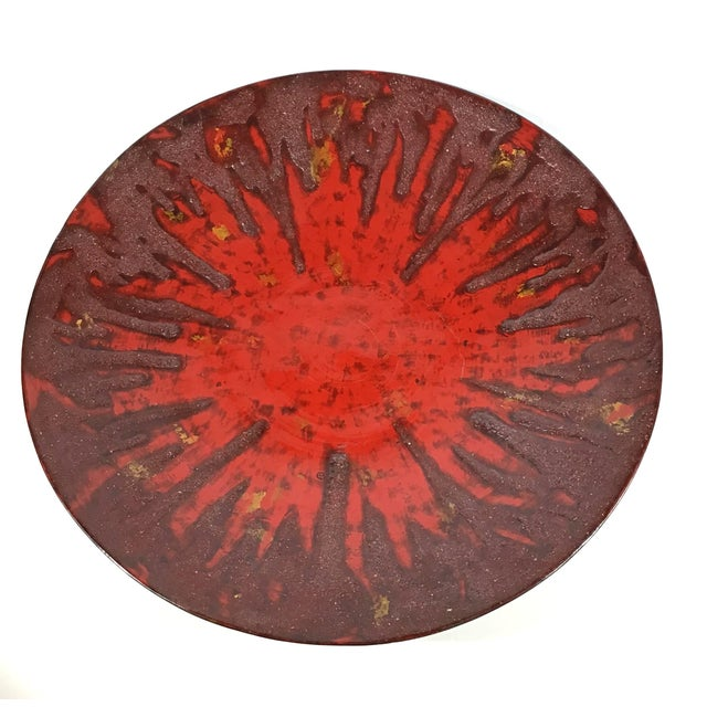 An exceptional large round platter or bowl made in Vietnam of thick traditional lacquer over wood. The method used for...