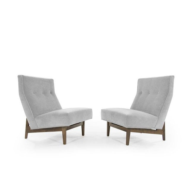 A set of slipper chairs designed by Jens Risom, circa 1950s. This pair has been fully restored down to its bones, fitted...